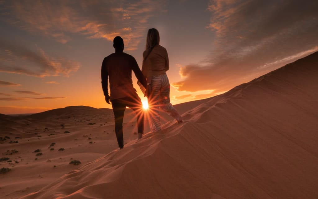 Morocco-desert-review-sunset-couple